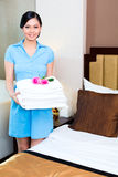 Chambermaid cleaning in hotel room Stock Photo