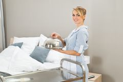 Chambermaid holding food tray Royalty Free Stock Photography