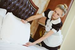 Chambermaid woman at hotel service Stock Photography