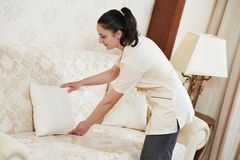 Chambermaid woman at hotel service Stock Photos