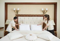 Chambermaid woman team at hotel service Royalty Free Stock Image
