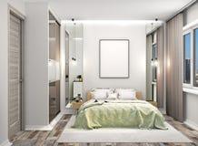 Chambre à coucher confortable avec une garde-robe avec les portes reflétées à côté du lit La toile vide a accroché sur le mur au- photo libre de droits