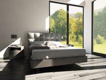 Chambre à coucher de conception moderne avec la vue de paysage Photographie stock libre de droits