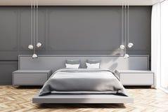 Chambre à coucher grise, lit gris Photos stock