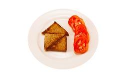Chambre de pain grillé avec des piments Photographie stock libre de droits
