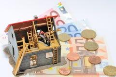 Chambre et argent Photographie stock libre de droits