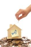 Chambre et argent avec une main Image stock