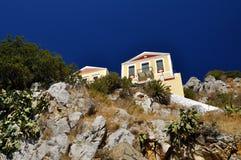 Chambre sur la roche, l'île de Symi, Grèce Photographie stock