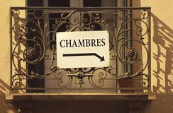 Chambres or Rooms to Rent Sign, France. Chambres (rooms to rent) or accomodation sign on an ornate balcony in Collioure, France stock photography