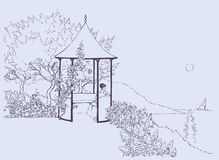 Chambrette confortable dans le jardin abondant près de la mer Photographie stock