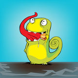 Chameleon with candy Royalty Free Stock Photos