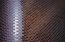 Chamfered corner of decorative brick wall. Abstract dark background with chamfered corner of decorative brick wall Stock Images