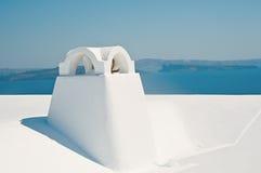 Chaminé em Oia na ilha de Santorini em Grécia Fotos de Stock