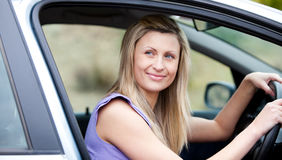 Chaming female driver at the wheel Royalty Free Stock Photography