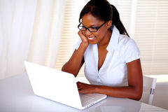 Chaming secretary browsing the internet on laptop Stock Image
