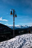 Lamppost and Graian Alps view. Chamois, Italy stock photo