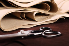 Chamois leather. The composition of brown and vanilla leather and shoe accessories Royalty Free Stock Images