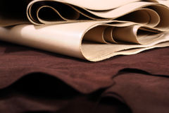 Chamois leather. The composition of brown and vanilla leather and shoe accessories Royalty Free Stock Photography