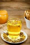 Chamomile - camomile tea on table Royalty Free Stock Image