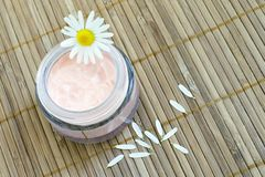 Chamomile and face cream Stock Images