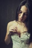 Chamomile flower. Bloody bride with chamomile in dark empty room royalty free stock photos
