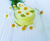 Chamomile flower, cosmetic treatment moisturizer cream on a wooden background stock images