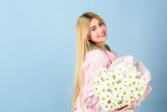 Chamomile flower symbol of innocence and tenderness. Celebrating her special day. Surprise for girlfriend. Adore flowers. Girl tender sensual blonde hold stock images