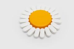 Chamomile shaped pills Royalty Free Stock Image