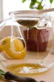 Chamomile-Tarragon infusion tea set. Preparation of Chamomile-Tarragon infusion receipt. Strain the honey into the teacup step royalty free stock image