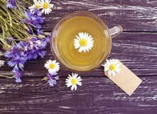 Chamomile tea, cornflower retro on a wooden background. Chamomile tea cornflower on a wooden background retro Royalty Free Stock Photo