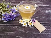 Chamomile tea, cornflower retro on a vintage wooden background. Chamomile tea cornflower on a wooden background retro vintage Stock Images