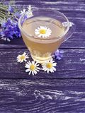 Chamomile tea, cornflower rustic retro on a vintage wooden background. Chamomile tea cornflower on a wooden background retro vintage rustic Stock Photos