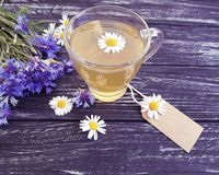 Chamomile tea, cornflower rustic morning retro on a vintage wooden background. Chamomile tea cornflower on a wooden background retro vintage rustic morning Stock Images