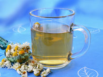 Chamomile tea with dried chamomile flowers. Chamomile tea in glass cup with dried chamomile flowers Stock Image