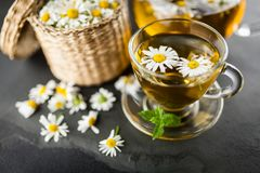 Cup of chamomile tea. Chamomile tea in a glass cup Royalty Free Stock Images