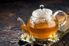 Chamomile tea in a glass teapot Stock Photography