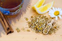 Chamomile tea with lemon and cinnamon Royalty Free Stock Photo