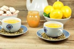 Chamomile tea, lemon and honey Stock Images