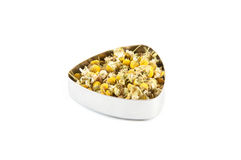 Chamomile tea. In a metal container Royalty Free Stock Photos