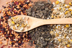 Chamomile tea, pomegranate and green tea and wooden spoon Royalty Free Stock Images