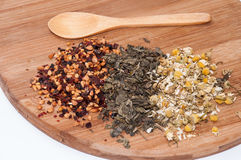 Chamomile tea, pomegranate and green tea and wooden spoon Stock Photo