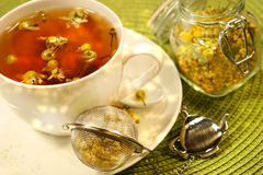 Chamomile tea with white tea cup Royalty Free Stock Photos