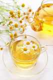 Chamomile tea on white wooden table Royalty Free Stock Image