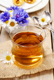 Chamomile tea on wooden table Royalty Free Stock Photography