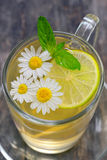 Chamomile tea on wooden table Stock Images