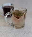 Chamomile teabag in glass mug on table Royalty Free Stock Image