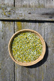 Chamomile in wicker basket Stock Photography