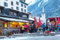 Outdoor Bar during Happy hour in Chamonix town, French Alps, France. Chamonix, France - January 25, 2015: Outdoor Bar during Happy hour and people relaxing after Stock Photo