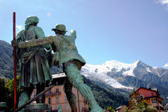 CHAMONIX in French Alps. The Statues of Balmat and de Saussure watching the mountains from Chamonix in France royalty free stock images