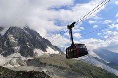 Chamonix Mont Blanc. Cable car in the French Alps. Funicular in mountains. Chamonix Mont Blanc. Suspension cable car in the French Alps. Funicular in the Stock Photos